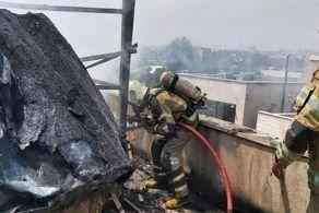 آتش به جان یک ساختمان در خیابان کارگر تهران افتاد + عکس